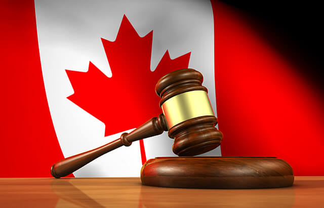 image of a gavel in front of a Canadian Flag