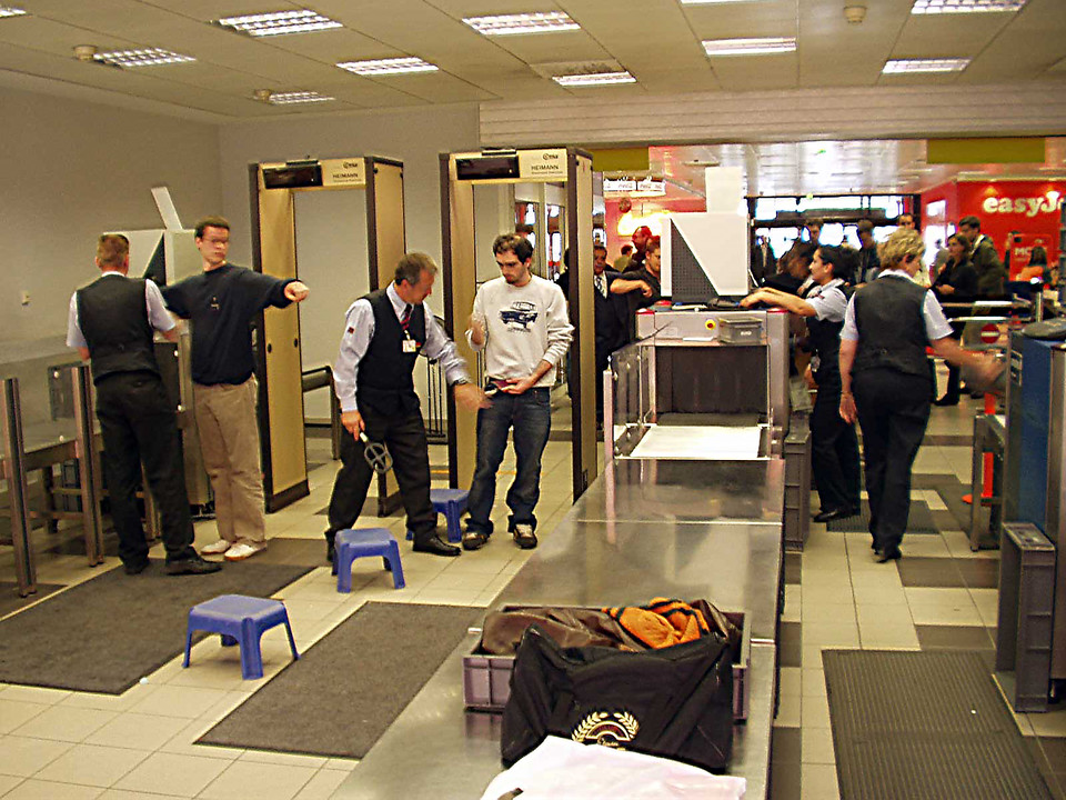 airport security checking passengers